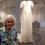 Mrs. Braun, standing by a dress made of acrylic paint.