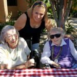 Two of our residents with an associate enjoying the BBQ.