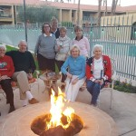 Our residents and the Avondale putters group by the fire pit.