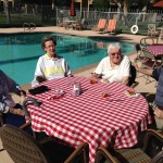 Residents eating by the pool.
