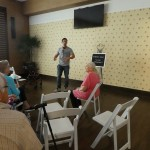 The director of the commercial giving the residents and other extras instructions.