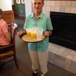 Mrs. Culkins serving OJ to the residents.