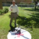 Dr. Julian next to our toy helicopter pad.