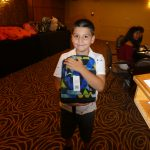 Zaid posing with his backpack.