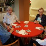 Residents enjoying their weekly game of Bridge during the holidays. Everyone is invited to join us for a fun afternoon.
