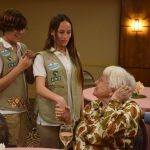 Girl Scouts greeting the residents